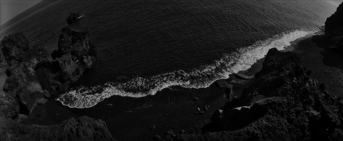 white wave on the black beach - stromboli
